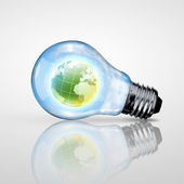Electric light bulb and planet inside it — Stock Photo