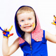 Happy child with paint on the hands — Stock Photo