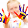 Stock Photo: Happy child with paint on the hands