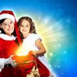 Little girl with christmas gifts and santa — Stock Photo #14563379