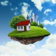 A piece of land in the air with house and tree. — Stock Photo