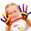 Happy child with paint on the hands - Stock Photo