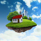 A piece of land in the air with house and tree. — Foto de Stock