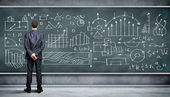 Business person against the blackboard — Stockfoto
