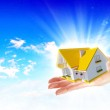 The house in hands on blue sky — Stock Photo #14786403