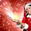 Portrait of girl wearing santa claus clothes - ストック写真