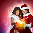 Little girl with christmas gifts and santa — Foto de Stock