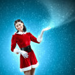Portrait of girl wearing santa claus clothes — Stock Photo