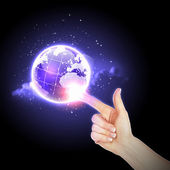 Hand touching the earth — Stock Photo