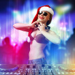 Female dj in christmas wear — Stock Photo #15773817
