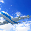 White passenger plane in blue sky — Stock Photo #15774353