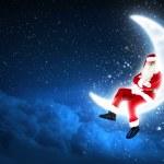 Photo of santa claus sitting on the moon — Stock Photo #15774825