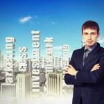 Businessman against cityscape — Stock Photo