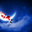 Photo of santa claus sitting on the moon — Stock Photo #15776185