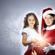 Little girl with christmas gifts and santa — Stock Photo #15776293