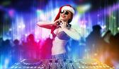Female dj in christmas wear — ストック写真