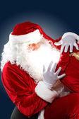 Santa claus with his gift bag — Stock Photo