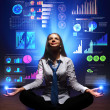 Business woman with financial symbols around — Stock Photo