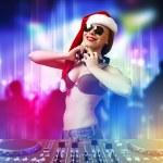 Female dj in christmas wear — Stock Photo #15869797