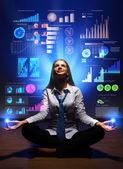 Mujer de negocios con símbolos financieros alrededor de — Foto de Stock
