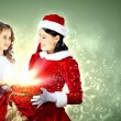 Little girl with christmas gifts and santa — Stock Photo #16016461