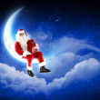 Stock Photo: Photo of santa claus sitting on the moon