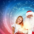 Foto Stock: Portrait of santa claus with a girl