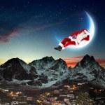 Photo of santa claus sitting on the moon — Stock Photo #16016977