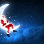 Photo of santa claus sitting on the moon — Stock Photo #16030687