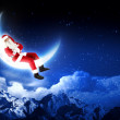 Photo of santa claus sitting on the moon — Stock Photo #16031129