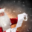 Santa with christmas letter — Stock Photo #16031969