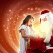 Stockfoto: Portrait of santa claus with a girl