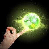 Hand röra jorden — Stockfoto