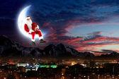 Foto de santa claus sentado en la luna — Foto de Stock