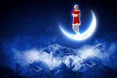Photo de fille de santa assise sur la lune — Photo