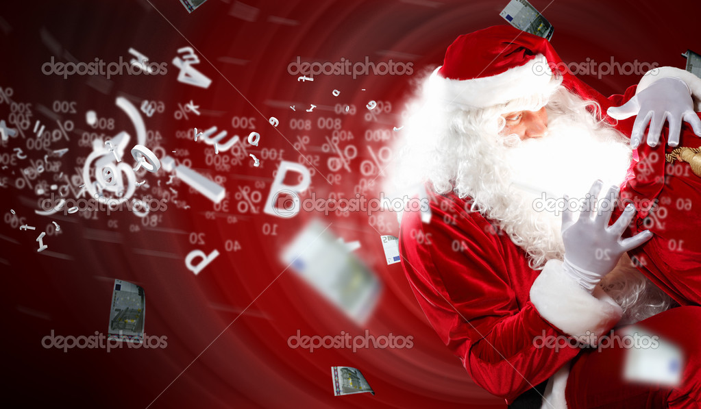 Santa with beard and red hat holding and looking into the sack  Stock Photo #16030883