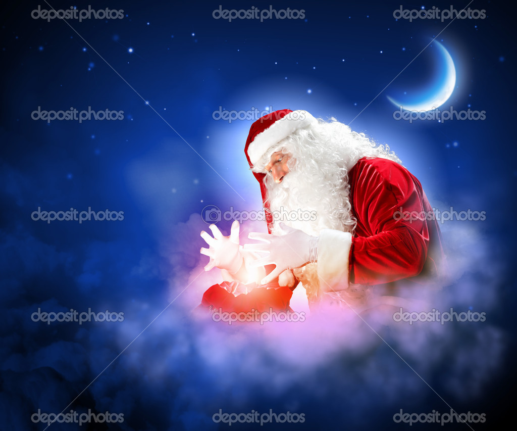 Santa with beard and red hat holding and looking into the sack — Stock Photo #16030925