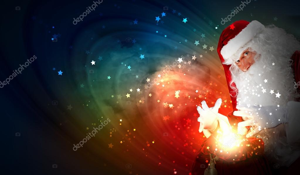 Santa with beard and red hat holding and looking into the sack  Stock Photo #16031195