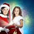 Foto Stock: Little girl with christmas gifts and santa