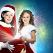 Little girl with christmas gifts and santa — Stock Photo #16243941