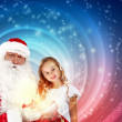 Stock Photo: Portrait of santa claus with a girl
