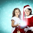 Royalty-Free Stock Photo: Little girl with christmas gifts and santa