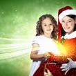 Little girl with christmas gifts and santa — Stockfoto