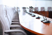 Conference hall with microphones — Stock Photo