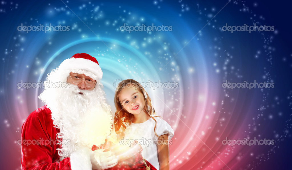Portrait of Santa Claus with a little girl looking at a gift — Photo #16244015