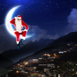 Royalty-Free Stock Photo: Photo of santa claus sitting on the moon