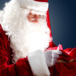 Santa claus with his gift bag — Stock Photo #16357187