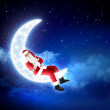 Photo of santa claus sitting on the moon — Stock Photo #16357343