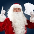 Royalty-Free Stock Photo: Santa claus reading a letter