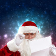 Santa with christmas letter — Stock Photo